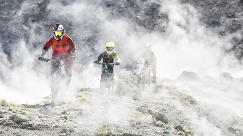 THREE YOUNG BIKERS, ONE VOLCANO